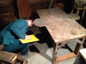 Nicole cataloguing painting table at Upper Bay Museum
